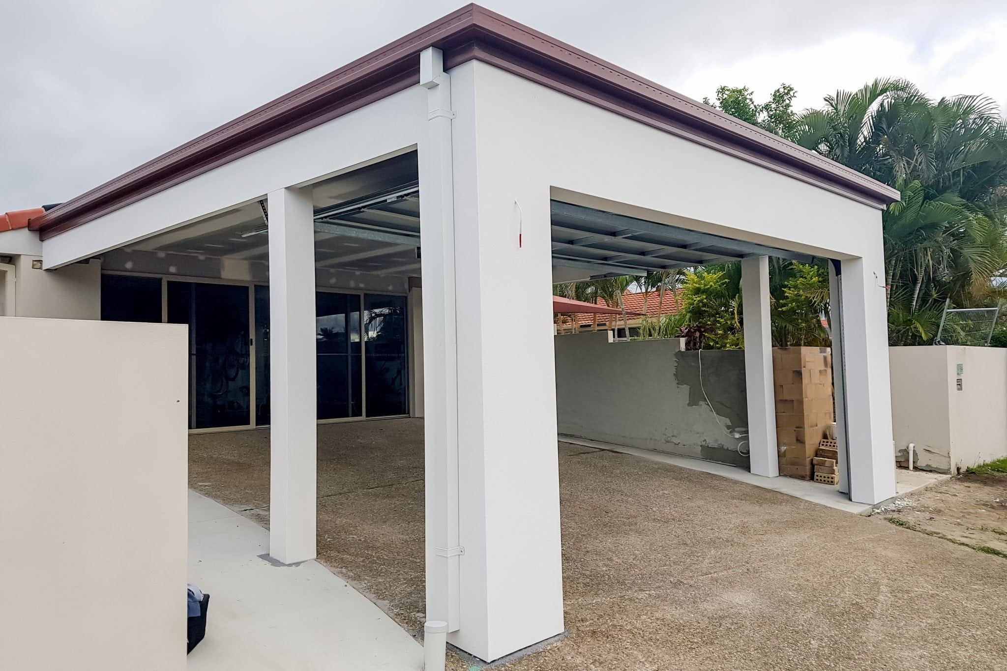Carport and residential house rendered by trade qualified Gold Coast Precision Rendering